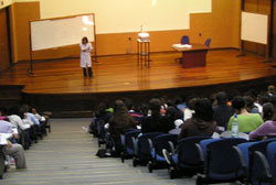 A person giving a presentation in an auditorium